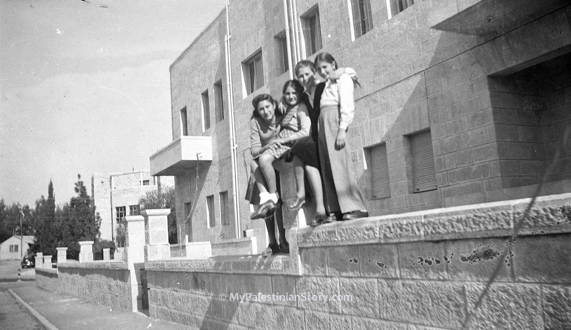 Feely, Jenny, Anna, Mary on the fencing wall of what was to be the Jordanian Embassy
